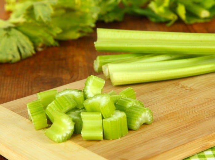 Fresh green celery on table close-up