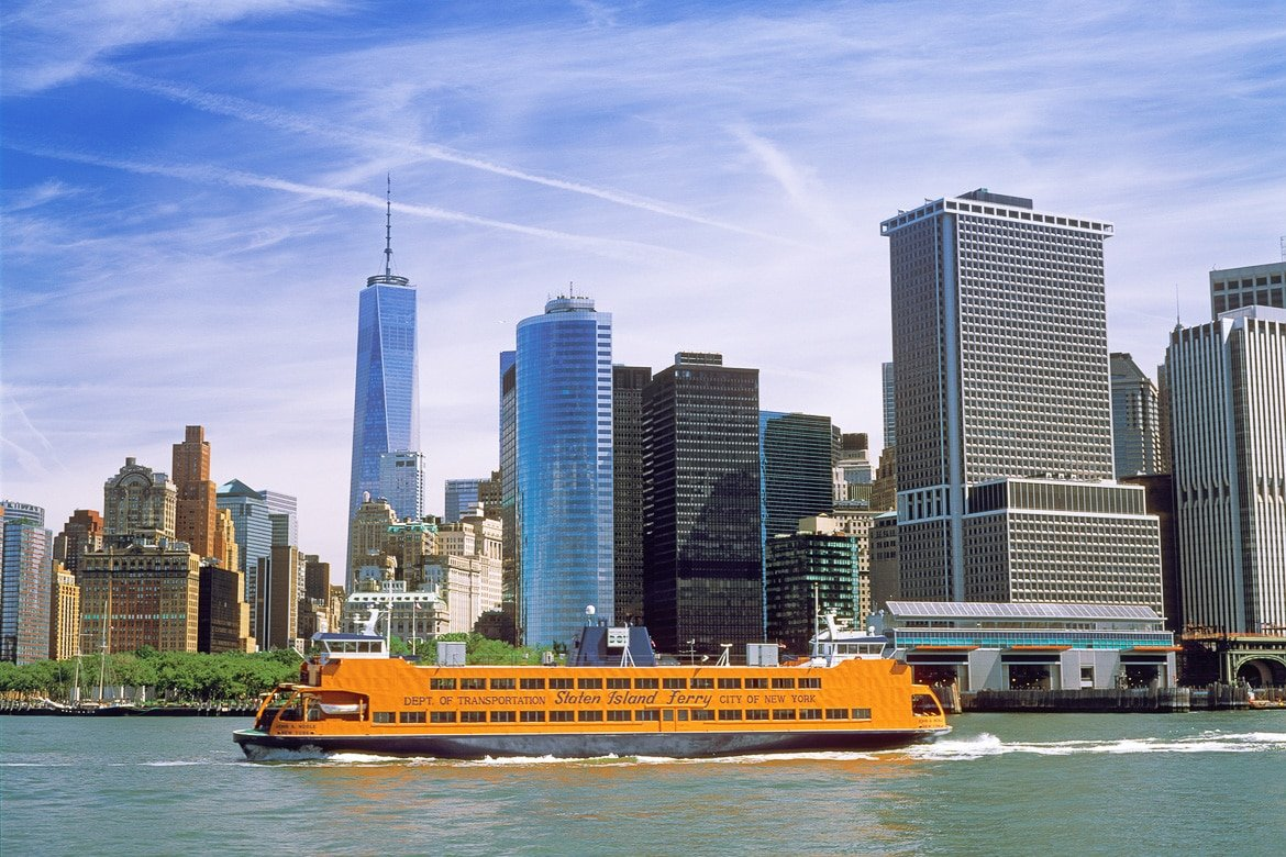 New York City USA - June 19 2014: Staten Island Ferry on the East River. Showing the Battery Maritime Building terminal for the Staten Island Ferry and the ferry to Governors Island.