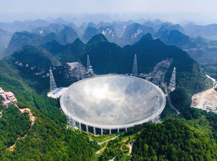 In this Saturday, Sept. 24, 2016 photo released by Xinhua News Agency, an aerial view shows the Five-hundred-meter Aperture Spherical Telescope (FAST) in the remote Pingtang county in southwest China's Guizhou province. China has begun operating the world's largest radio telescope to help search for extraterrestrial life. (Liu Xu/Xinhua via AP)